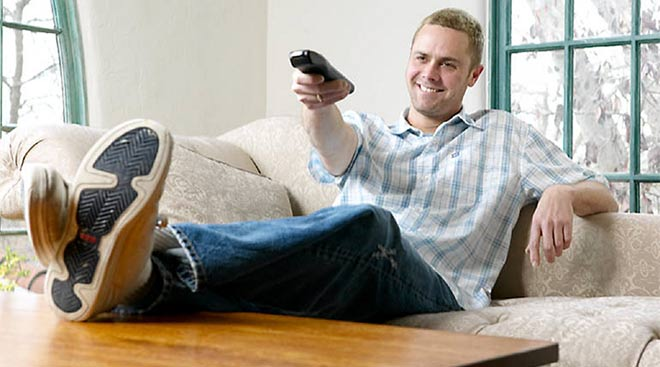 man_relaxing_at_home_13419264431