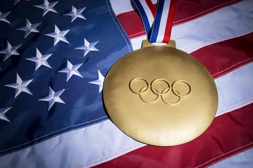 HOW AN OLYMPIC GOLD MEDAL BECOMES COLD HARD CASH