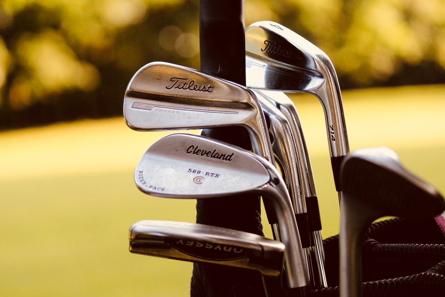 A group of iron golf clubs