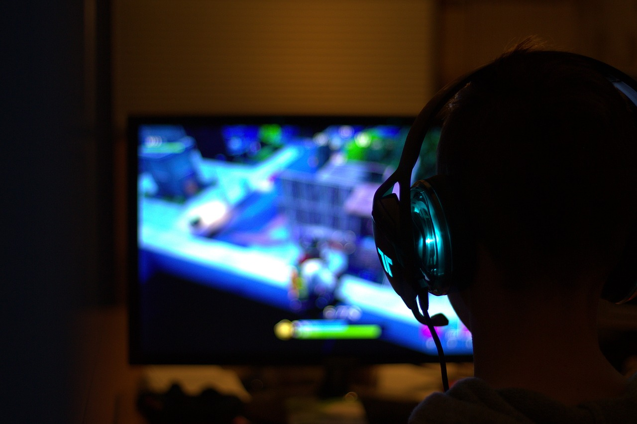 Person with headset playing fortnight