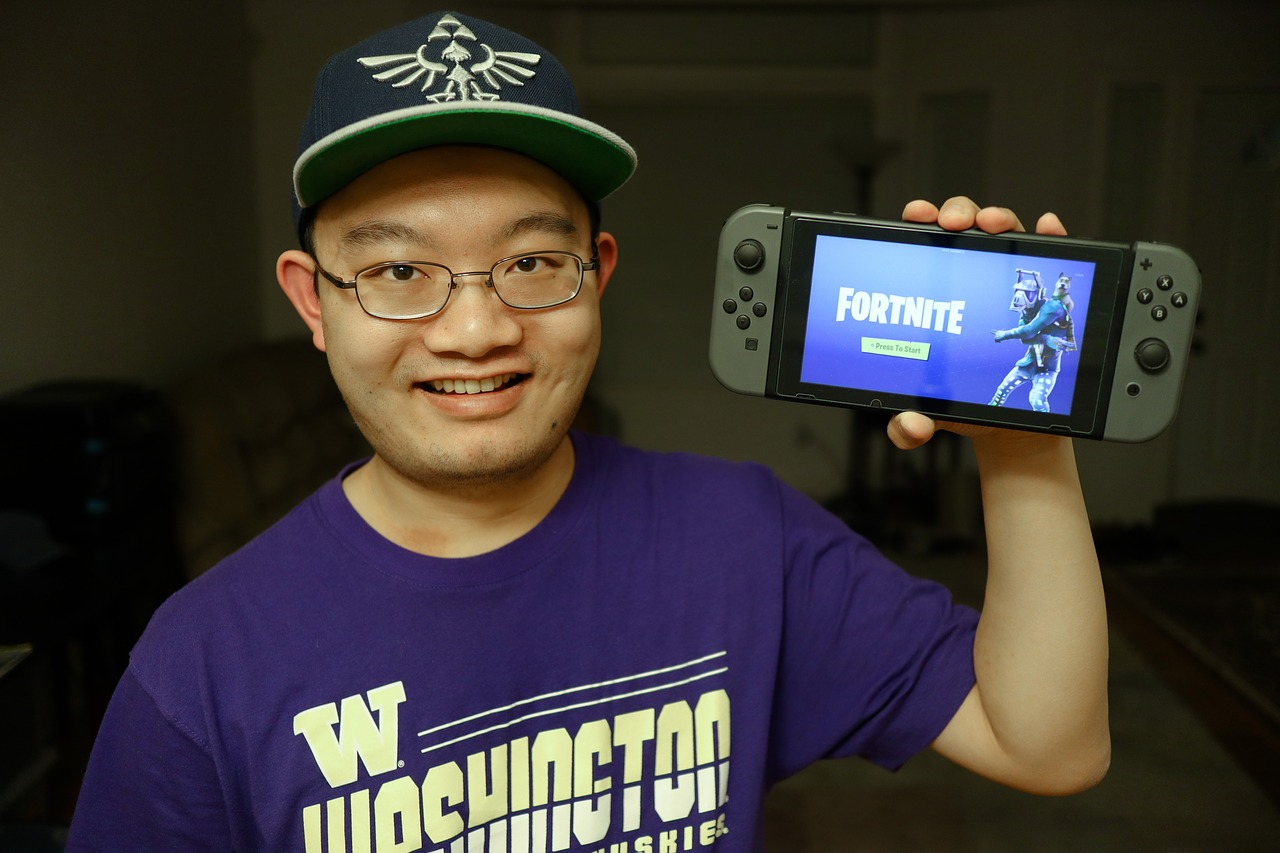 Man holding Nintendo switch