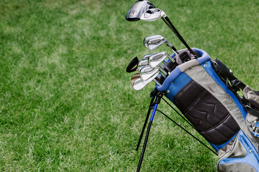 Different kinds of best golf clubs inside the blue and black bag